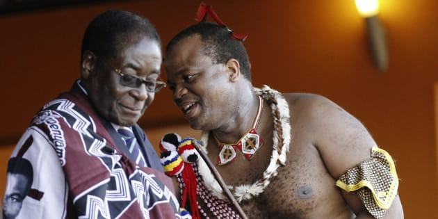 Zimbabwe's President Robert Mugabe (L) chats with Swaziland's King Mswati III during the annual Reed Dance at Ludzidzini in Swaziland August 30, 2010. Encouraging the assassination of a head of state, even if it is a vile one, violates South Africa's laws.