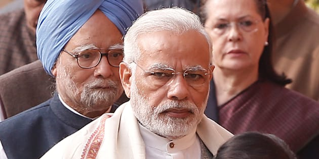 Prime Minister Narendra Modi (C), former Prime Minister Manmohan Singh (L) and Sonia Gandhi, leader of India's main opposition Congress Party, wait to pay homage to the victims of the December 2001 parliament attack on its anniversary in New Delhi, India, December 13, 2017. REUTERS/Adnan Abidi