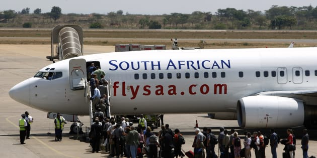 Passengers board a South African Airways Boeing 737 aircraft at the Kamuzu International Airport in Lilongwe on October 25 2009.