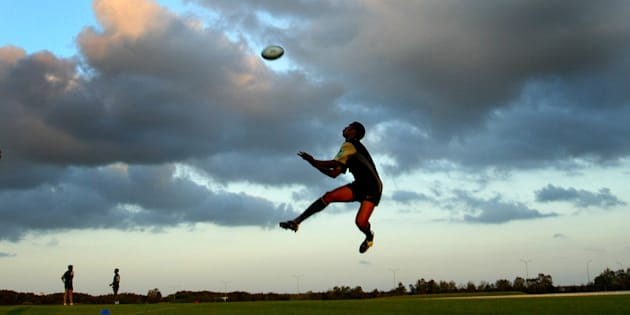 South Africa's Ashwin Willemse takes a high ball during a training session in Brisbane, October 27, 2003. Saturday.