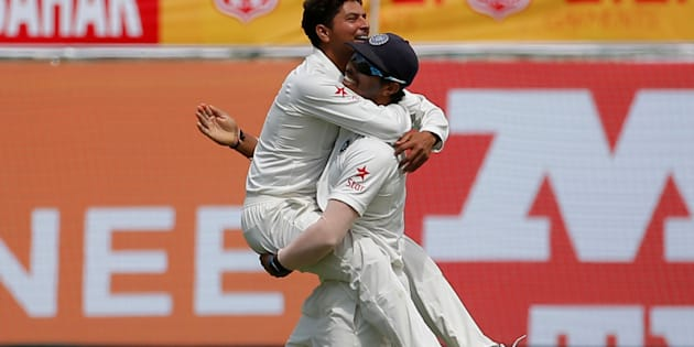 That's the 'Chinaman' Kuldeep Yadav (left) celebrating getting out Glenn Maxwell.