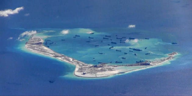 FILE PHOTO: Chinese dredging vessels are purportedly seen in the waters around Mischief Reef in the disputed Spratly Islands in the South China Sea in this still image from video taken by a P-8A Poseidon surveillance aircraft provided by the United States Navy May 21, 2015.  U.S. Navy/Handout via Reuters/File Photo   ATTENTION EDITORS - THIS IMAGE WAS PROVIDED BY A THIRD PARTY. EDITORIAL USE ONLY. THIS PICTURE WAS PROCESSED BY REUTERS TO ENHANCE QUALITY. AN UNPROCESSED VERSION IS AVAILABLE IN OUR ARCHIVE.