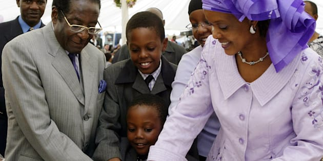 Happier days: Zimbabwe's President Robert Mugabe (L), his wife Grace (R) and children Chatunga (C front), Robert Jnr (C rear) and Bona (with glasses) cut the cake at his birthday party in Zvimba, 80 km's west of Harare February 21, 2004.
