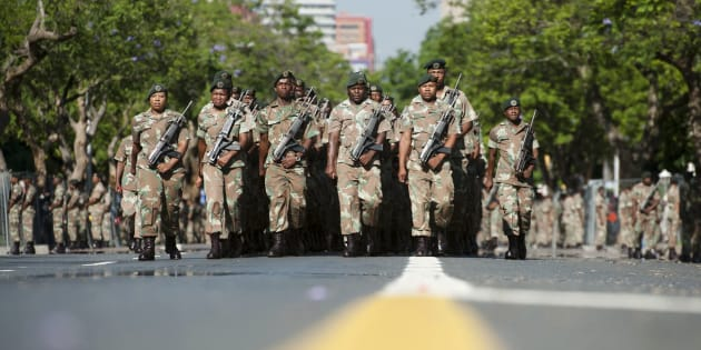 South African National Defence Force (SANDF) soldiers parade on the streets near the Union Buildings in Pretoria on December 12, 2013.