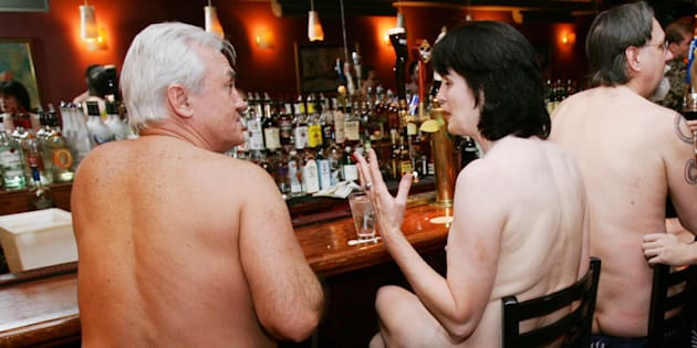 """A group of nudists at a bar during a """"Clothing Optional Dinner"""" at a New York City restaurant"""