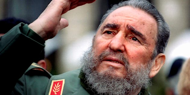 Cuba's President Fidel Castro gestures during a tour of Paris in this March 15, 1995 file photo.