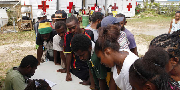 People sign up for assistance at a Red Cross aid centre, days after Cyclone Pam in Port Vila, capital city of the Pacific island nation of Vanuatu March 19, 2015. REUTERS/Edgar Su