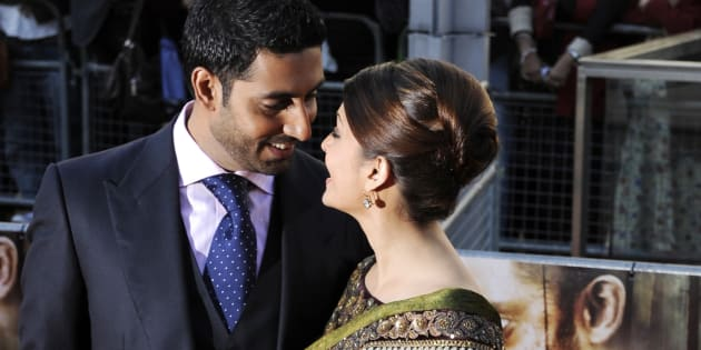 Married Bollywood couple Abhishek Bachchan (L) and Aishwayra Rai Bachchan arrive for the world premiere of their film 'Raavan' at the BFI in London, June 16, 2010. REUTERS/Paul Hackett (BRITAIN - Tags: ENTERTAINMENT SOCIETY)