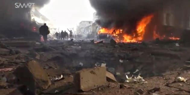An image grab taken from an AFPTV video released on January 7, 2017 shows people gathering amidst the debris at the site of a car bomb attack in the rebel-held town of Azaz in northern Syria. According to the Syrian Observatory for Human Rights, at least 43 people were killed and dozens injured in the blast that ripped through the town near the Turkish border.   / AFP / AFPTV / STRINGER        (Photo credit should read STRINGER/AFP/Getty Images)