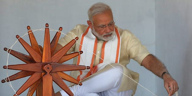 India's Prime Minister Narendra Modi spins cotton on a wheel during his visit to Gandhi Ashram in Ahmedabad, India, June 29, 2017. REUTERS/Amit Dave