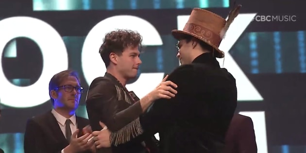 Arkells singer Max Kerman embraces musician Jeremy Dutcher at the Junos gala dinner and awards on March 16, 2019.
