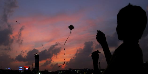 A boy flies a kite in the evening in Chennai February 2, 2007. REUTERS/Babu (INDIA)