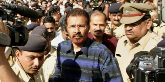 File photo -- DG Vanzara being escorted by the police following an appearance in the magistrates court in Ahmedabad, 01 May 2007.