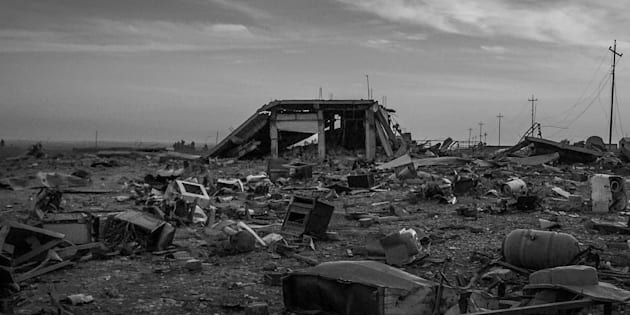 MOSUL, IRAQ - NOVEMBER 13: (EDITORS NOTE: Image shot in black and white using a panoramic app on an iPhone 6.) A building is seen destroyed on a road leading to Mosul on November 13, 2016 in Mosul, Iraq. ISIL took control of Mosul, Iraq's second largest city in June of 2014. For the past two years they have occupied the city. On the 17th of October 2016. Iraqi forces began the Mosul offensive to take back the city. The offensive was a joint effort by Iraqi Government forces, the Peshmerga, local tribal militias and air support from the US and UK military. Despite early progress the offensive has slowed in the past week as Iraqi forces encountered heavy resistance from ISIL fighters entrenched inside the city. The use of an extensive tunnel system under the city built by ISIL over the past two years, booby traps, snipers and roads riddled with IED's has slowed the advance of troops on the ground. As the offensive enters its fourth week, fears of a humanitarian crisis grow as up to 1 million civilians are believed to be trapped inside the city.  (Photo by Chris McGrath/Getty Images)