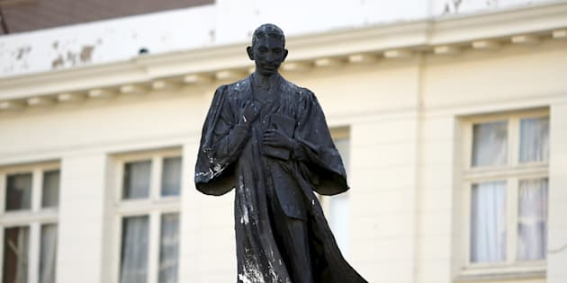 A statue of Mahatma Gandhi is seen after it was vandalized with white paint at Ghandi Square in Johannesburg April 13, 2015. REUTERS/Siphiwe Sibeko