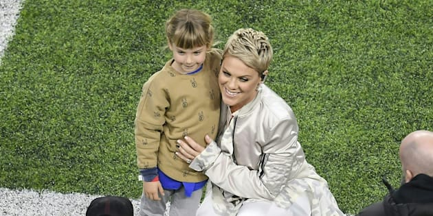 Recording artist Pink poses with her daughter before singing the US National Anthem for the start of Super Bowl LII on February 4, 2018 in Minneapolis, Minnesota.