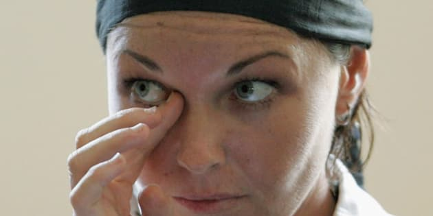 Schappelle Corby wipes her eye during a court hearing in Denpasar District Court in 2006.