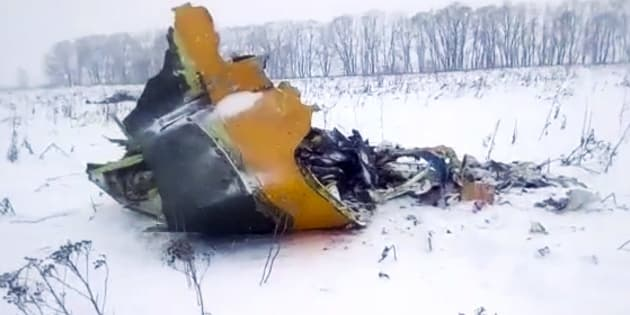 The wreckage of a AN-148 plane is seen in Stepanovskoye village, about 40 kilometers from the Domodedovo airport, in Russia on Sunday.