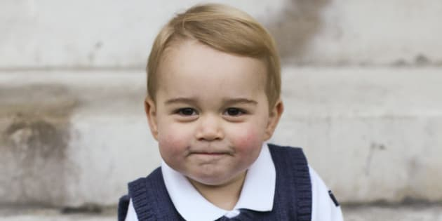 Prince George sits for his official Christmas picture in a courtyard at Kensington Palace in late Nov. 2014 in London, England.