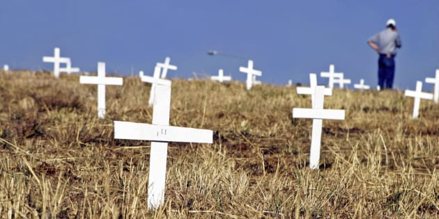 1,500 white crosses have been planted next to the John Vorster off-ramp near the N1 in Centurion as evidence and as a protest for the 1,500 people who have died due to farm attacks, shown here on July 27, 2003, in Pretoria, South Africa.