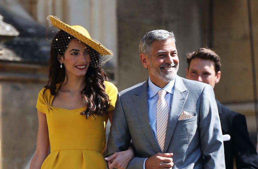 9d28751171c Royal Wedding 2018  Amal Clooney stuns in Stella McCartney marigold dress