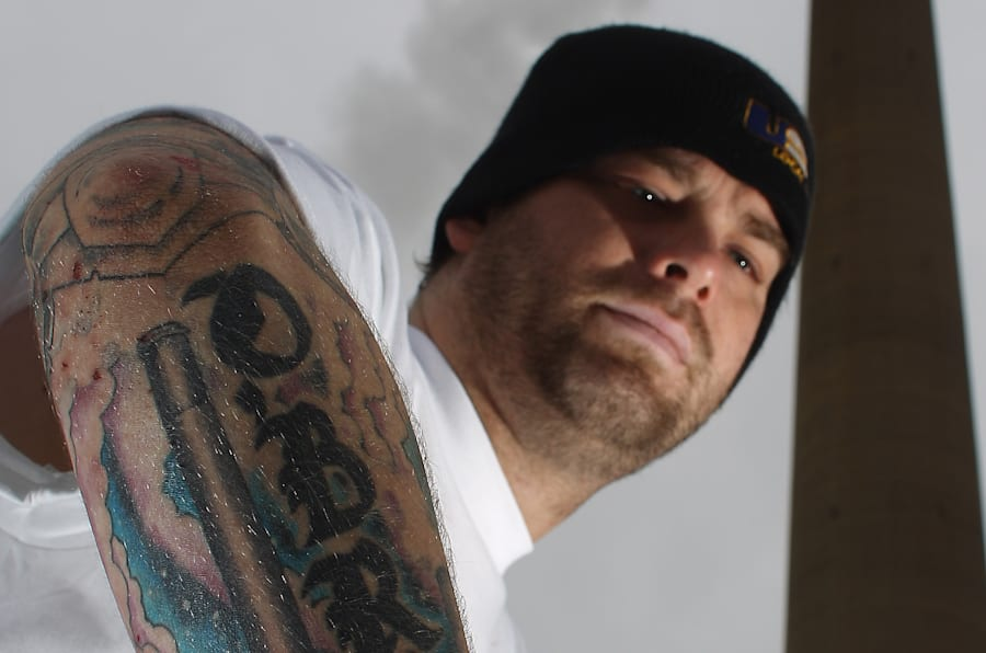 Third-generation miner Mickey O'Brien has the Superstack and the Copper Cliff smelter tattooed on his forearm.