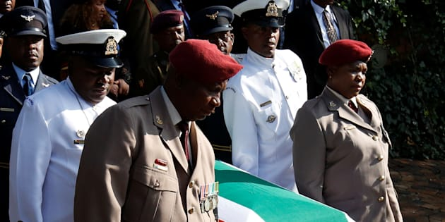The coffin of Winnie Madikizela-Mandela is carried from her home ahead of her funeral in Soweto.