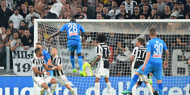 Soccer Football - Serie A - Juventus v Napoli - Allianz Stadium, Turin, Italy - April 22, 2018   Napoli's Kalidou Koulibaly scores their first goal    REUTERS/Massimo Pinca