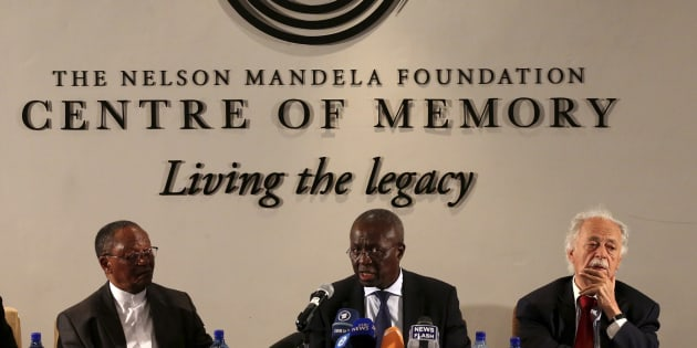 Deputy chief justice Dikgang Moseneke (C) reads Nelson Mandela's will flanked by professor Njabulo Ndebele (L) and advocate George Bizos on February 3 2014.
