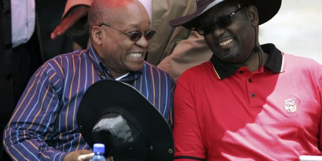 South Africa's President Jacob Zuma (L) chats with Zwelinzima Vavi (R).