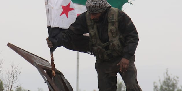 Convoys carried opposition fighters out of the last rebel pocket of Aleppo on Thursday.