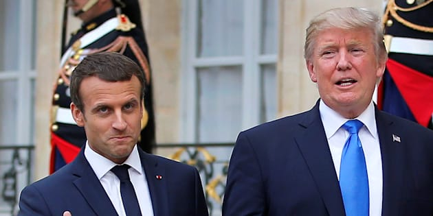 French President Emmanuel Macron and U.S. President Donald Trump react in the courtyard after a joint news conference at the Elysee Palace in Paris, France, July 13, 2017.   REUTERS/Stephane Mahe     TPX IMAGES OF THE DAY
