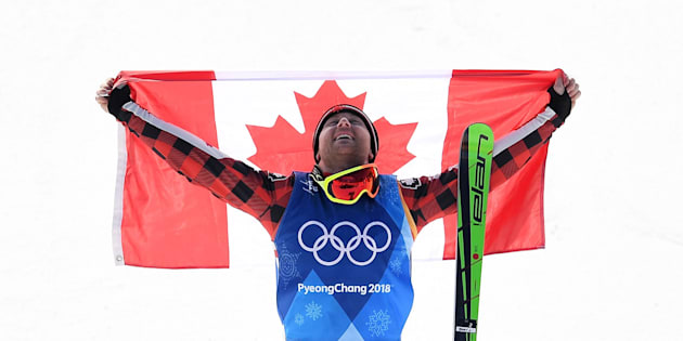 Gold medallist Canada's Brady Leman celebrates during the victory ceremony after the men's ski crossfinal.