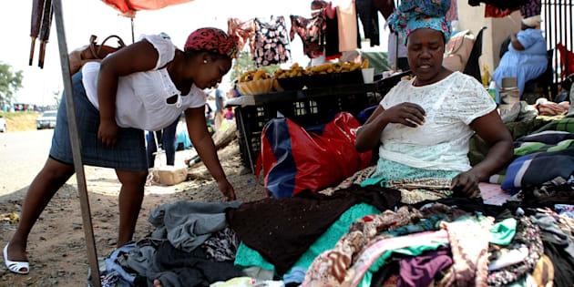 A woman sells clothes at a flea market outside SASSA pay point in March 2017 in Mpumalanga.