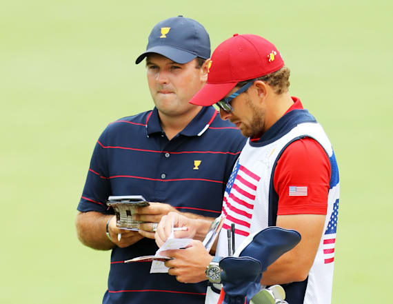 Patrick Reed's caddie punches fan at Presidents Cup