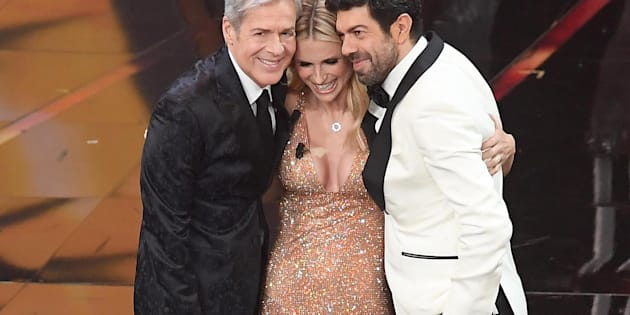 Italian singer and Sanremo Festival artistic director Claudio Baglioni (L), Swiss-Italian TV showgirl Michelle Hunziker (C) and Italian actor Pierfrancesco Favino (R) on stage during the 68th Sanremo Italian Song Festival at the Ariston theatre in Sanremo, Italy, 10 February 2018. The 68th edition of the television song contest runs from 06 to 10 February.   ANSA/CLAUDIO ONORATI