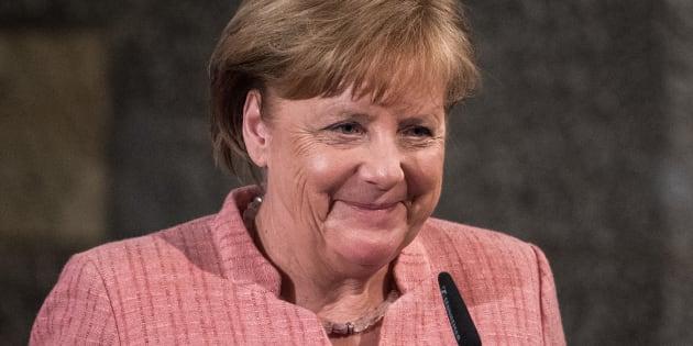 Angela Merkel riceve la lampada della pace, donata dai frati di Assisi