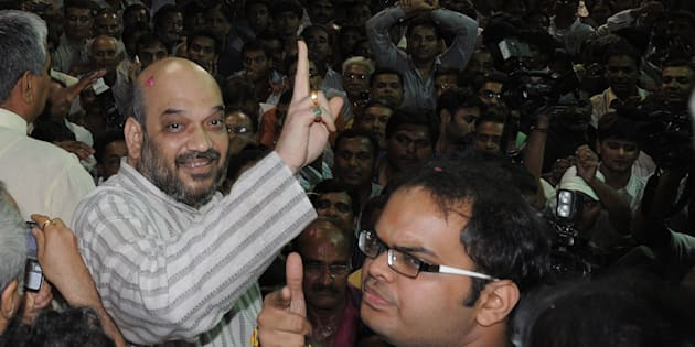 File photo of Indian politician and former Gujarat minister Amit Shah (L) and his son Jay celebrating on his arrival at his residence after his release from Sabarmati Central Jail in Ahmedabad late on October 29, 2010.