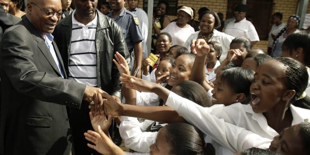 African National Congress (ANC) president Jacob Zuma greets pupils at  Bhukulani secondary school  in Soweto January 14 2009. Zuma was there to assess conditions under which learners are educated at the school in South Africa's biggest township.