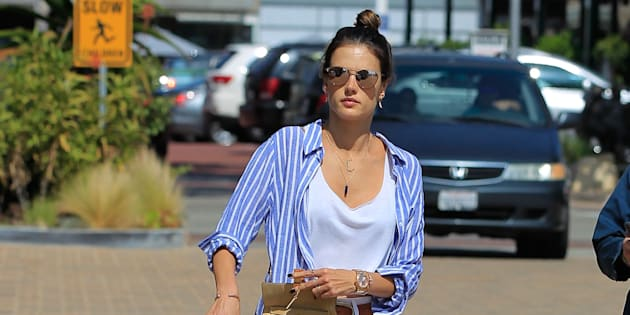 52056979 Victoria's Secret model Alessandra Ambrosio and her partner Jamie Mazur were spotted before and after her work out in Malibu, California on May 14, 2016.  She went in with a blue and white striped shirt and came out with a white sweater and leggings.  She drank a green drink afterwards. FameFlynet, Inc - Beverly Hills, CA, USA - +1 (310) 505-9876