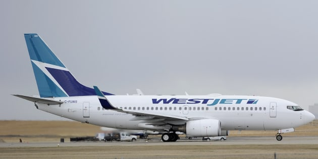 A WestJet plane takes off at the International Airport in Calgary on May 3, 2011.