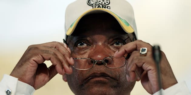 Can he see more clearly now? Jacob Zuma puts on his reading glasses.