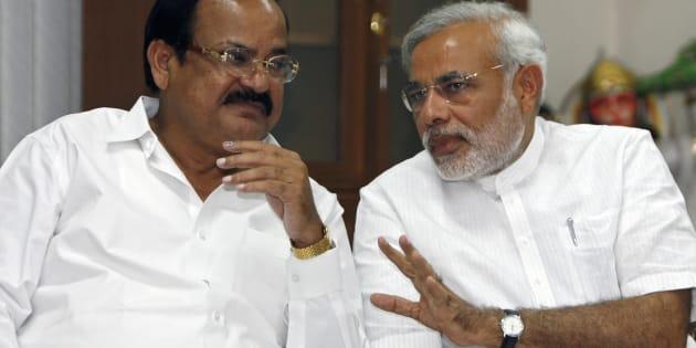 Venkaiah Naidu (L) and Narendra Modi at a meeting in New Delhi May 18, 2009. REUTERS/Adnan Abidi