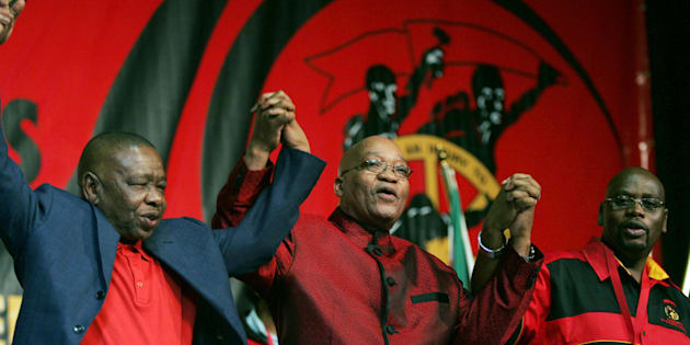 HAPPIER DAYS: President Jacob Zuma (C) holds hands with Blade Nzimande (L) and Sdumo Dlamini (R) at the opening of the 10th Congress of South African Trade Unions (Cosatu) in Johannesburg on September 21, 2009.