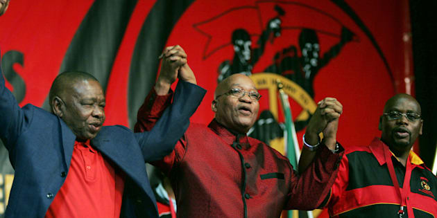 South African President Jacob Zuma (C) holds hands with Blade Nzimande (L) and President of Cosatu Sdumo Dlamini (R).