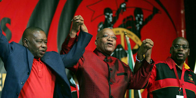 President Jacob Zuma (C) holds hands with former minister of higher education Blade Nzimande (L) and president of Cosatu, Sdumo Dlamini (R).