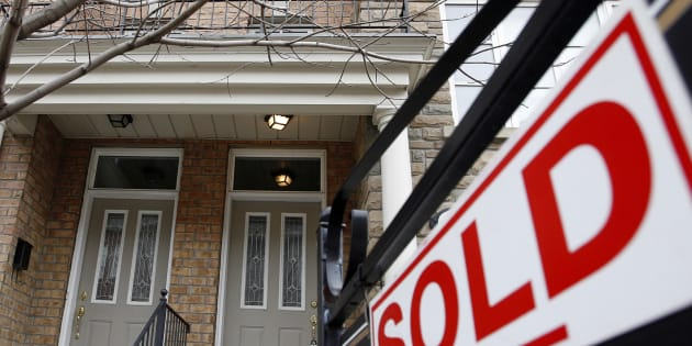 A sold sign is displayed in front of a home in Toronto Dec.15, 2009. A new stress test for homebuyers who don't need mortgage insurance will be required starting next year.