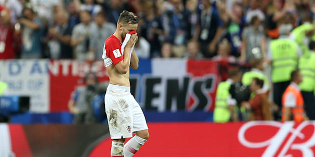 Croatia's Ivan Rakitic looks dejected after France score their fourth goal of the game during the FIFA World Cup 2018 final at the Luzhniki Stadium in Moscow, 15th July 2018