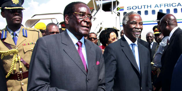Zimbabwe's President Robert Mugabe (2nd L) welcomes his South African counterpart Thabo Mbeki (2nd R) at Harare airport November 22, 2007.