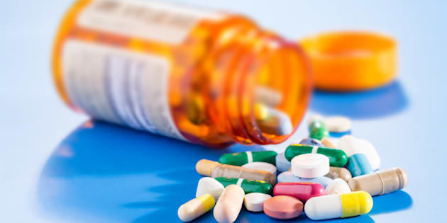 Pills and capsules in medical vial